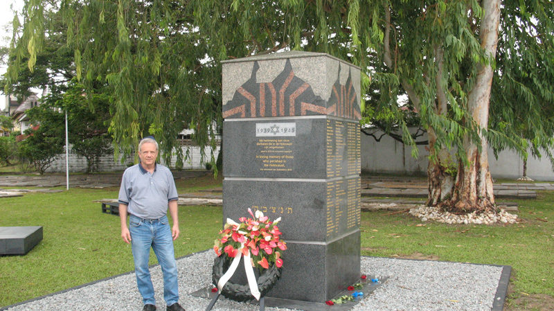Man in front of Holocaust memorial in Suriname
